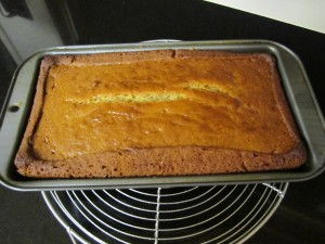 Baked cake cooling on rack